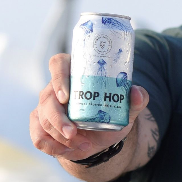 Guy holding Trop Hop Can